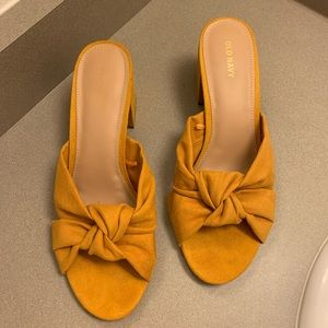 Mustard faux leather mule slides with bow